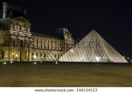 PARIS - SEP 24 : Night view of the Louvre, glass pyramid present, world's largest museums, most visited museum, more than 8 million visitors per year, opened from 1793 on Sep 24, 2012, Paris, France.