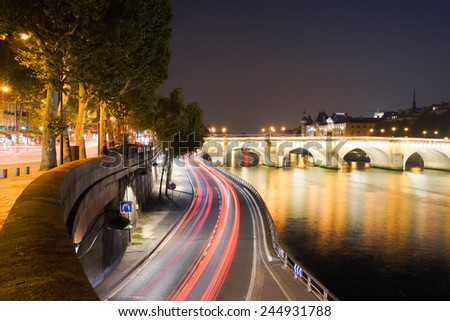 PARIS - SEP 06: Paris at night on September 06, 2014 in Paris, France. Paris, aka City of Love, is a popular travel destination and a major city in Europe - stock photo