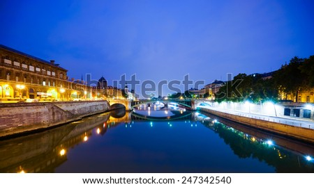 PARIS - SEP 05: Paris at night on September 05, 2014 in Paris, France. Paris, aka City of Love, is a popular travel destination and a major city in Europe - stock photo