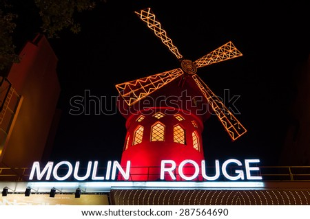 PARIS - SEPT 16, 2014: The Moulin Rouge at night. Moulin Rouge (French for Red Mill) is a famous cabaret and thater built in 1889, locating in the Paris red-light district of Pigalle. Paris, France. - stock photo