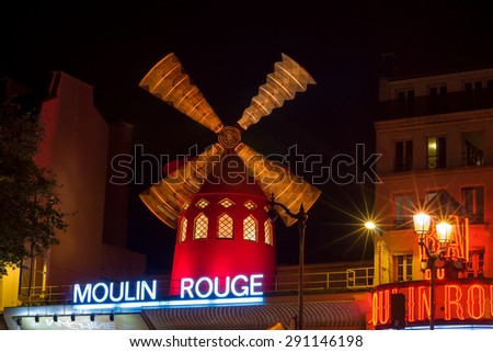 PARIS - SEPT 17, 2014: The Moulin Rouge at night. Moulin Rouge (French for Red Mill) is a famous cabaret and thater built in 1889, locating in the Paris red-light district of Pigalle. Paris, France. - stock photo