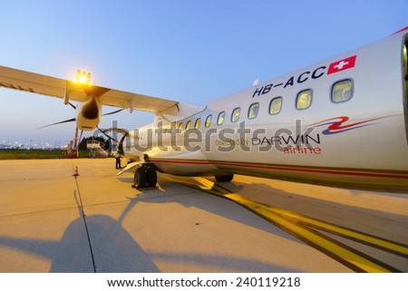 PARIS - SEPTEMBER 10: atr-72 in Charles de Gaulle Airport  on September 10, 2014 in Paris, France. Paris Charles de Gaulle Airport, is one of the world's principal aviation centres, - stock photo