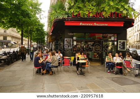 PARIS - SEPTEMBER 06: cafe exterior on September 06, 2014 in Paris, France. Paris, aka City of Love, is a popular travel destination and a major city in Europe - stock photo
