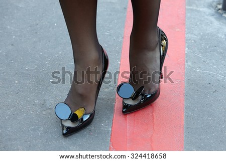 PARIS - SEPTEMBER 30: Christian Louboutin 'Madame Mouse' shoes before Rochas show, Paris Fashion Week Day 2, Spring / Summer 2016 street style on September 30, 2015 in Paris. - stock photo