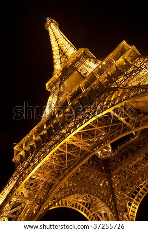 PARIS - SEPTEMBER 12: Details of the illuminated Eiffel Tower by night. The most recognizable landmark of the world. September 12, 2009 in Paris, France.