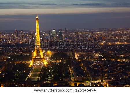 PARIS - SEPTEMBER 30: Eiffel tower at night on September 30, 2012 in Paris. Night in Paris with Eiffel tower, most visited monument of France with 200.000.000 visit - stock photo