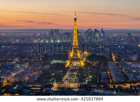 PARIS - 19 SEPTEMBER: Eiffel Tower brightly illuminated at dusk on May 22, 2008 in Paris. The Eiffel tower is the most visited monument of France - stock photo