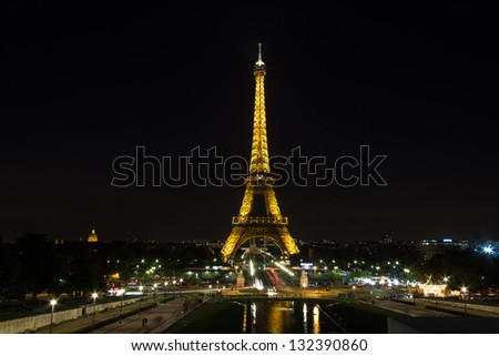 PARIS - SEPTEMBER 13: Eiffel tower with lights at night on September 13, 2012. Eiffel tower is the most famous sight of Paris.
