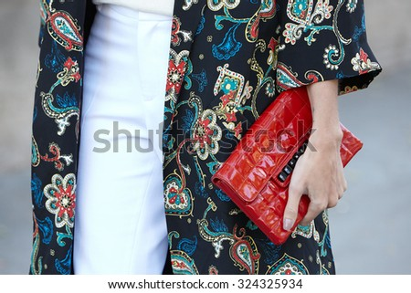 PARIS - SEPTEMBER 30: Helena Bordon poses for photographers with red Chanel bag before Rochas show, Paris Fashion Week Day 2, Spring / Summer 2016 street style on September 30, 2015 in Paris. - stock photo