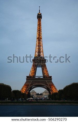 PARIS - SEPTEMBER 30, 2016: Illuminated Eiffel Tower at dusk. The tower is the most visited landmark of France.