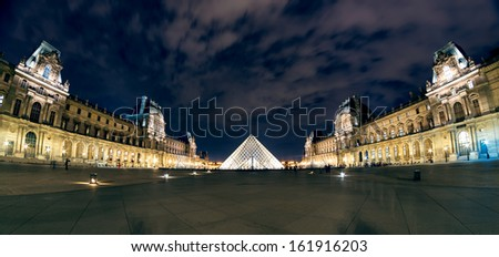 PARIS - SEPTEMBER 25: Louvre museum at night on september 25, 2013 in Paris. The Louvre is one of the largest museums in the world and one of the major tourist attractions of Paris.