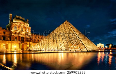 PARIS - SEPTEMBER 25, 2013: Louvre museum at night. The Louvre is one of the largest museums in the world and one of the major tourist attractions of Paris. - stock photo