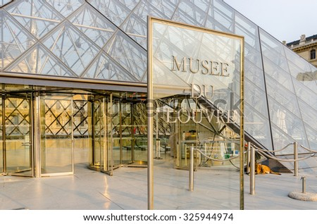 Paris - SEPTEMBER 18, 2012: Louvre Museum on September 18 in Paris, France. Louvre Museum is a popular tourist attraction in Paris - stock photo
