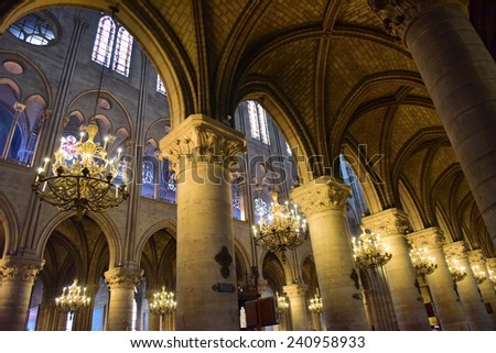 PARIS - SEPTEMBER 24: Majestic interior of the famous Notre Dame de Paris Cathedral, taken on September 24, 2014 in Paris, France