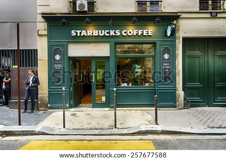 PARIS - SEPTEMBER 06: Starbucks cafe exterior on September 06, 2014 in Paris, France. Paris, aka City of Love, is a popular travel destination and a major city in Europe - stock photo