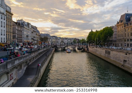 PARIS - SEPTEMBER, 18: Sunset near the river Seine in September, 2014 in Paris, France. Parisians and tourists stroll along the banks of the river Seine - stock photo