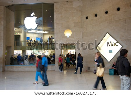 PARIS - SEPTEMBER 18: The Apple Store at the Carrousel du Louvre Museum. Interesting contrast of the latest technology and classic art, both loved by millions around the world, on September 18, 2013.