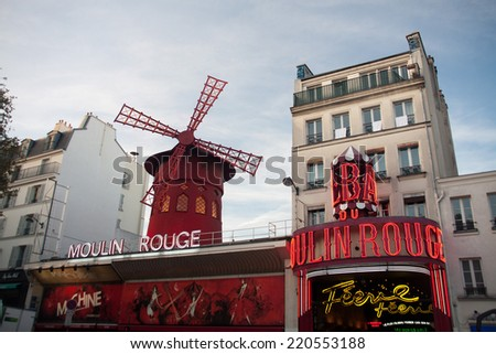 PARIS - September 28:The Moulin Rouge, on September 28, 2014 in Paris, France. Moulin Rouge is a cabaret in Paris,France. Built in 1889 by Joseph Oller and located in Paris district of Pigalle.  - stock photo