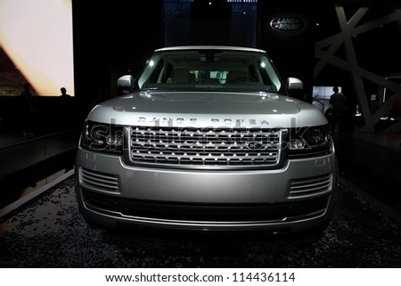 PARIS - SEPTEMBER 30: The new Range Rover displayed at the 2012 Paris Motor Show on September 30, 2012 in Paris - stock photo