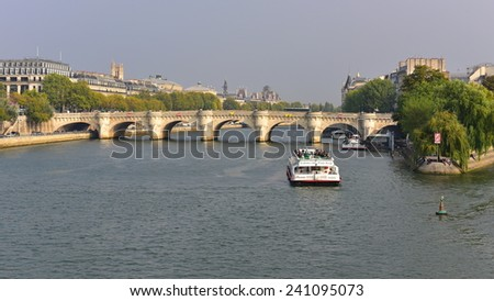 PARIS - SEPTEMBER 24: View of Pont Neuf arched stone bridge which opened in 1603, taken on September 24, 2014 in Paris, France