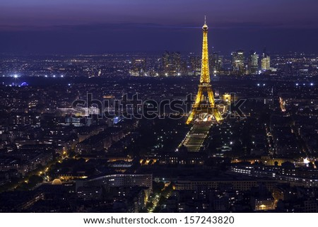 PARIS -  24 SEPTEMBER:  View of the Paris and Tower Eiffel on September 24, 2013 in Paris. The Eiffel tower is the most visited monument of France. The Eiffel tower stands 324 metres (1,063 ft) tall. - stock photo