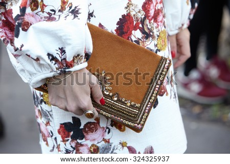 PARIS - SEPTEMBER 30: Woman with decorated bag poses for photographers before Yang Li show, Paris Fashion Week Day 2, Spring / Summer 2016 street style on September 30, 2015 in Paris.