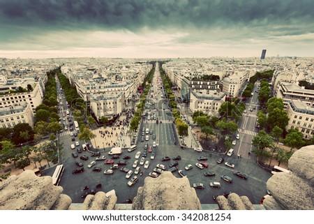 Paris skyline - avenue des Champs-Elysees. View from Arc de Triomphe, Paris, France. Vintage, retro - stock photo