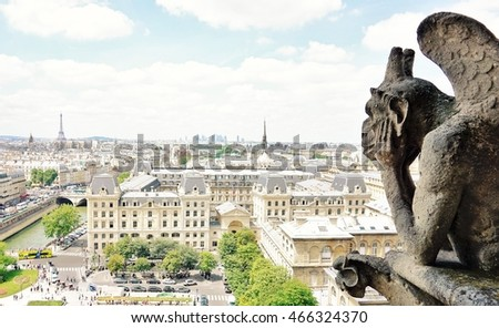 Paris Top view with famous demon in Notre-Dame Cathedral