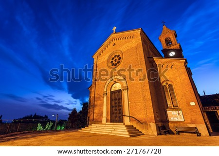 Parish church early in the morning in small italian town of Serralunga d'Alba in Piedmont, Northern Italy. - stock photo