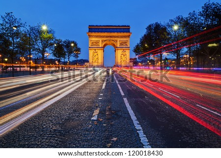 Parisian arc de Triomphe by night - stock photo