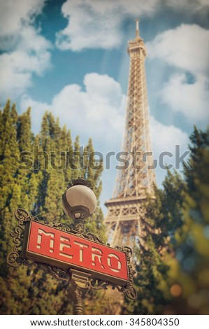 Parisian metro sign and Eiffel Tower