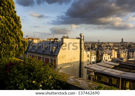 Parisian rooftop view on the sunset from the green terrace, Paris, France - stock photo