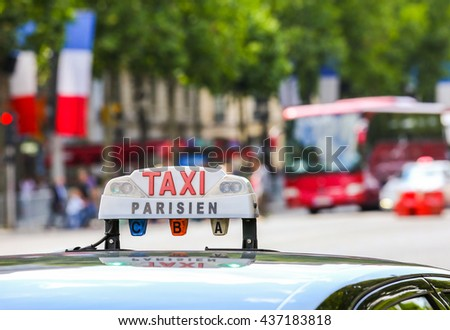Parisian taxi in the city - stock photo