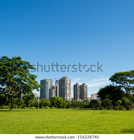 park and modern building in the city. - stock photo