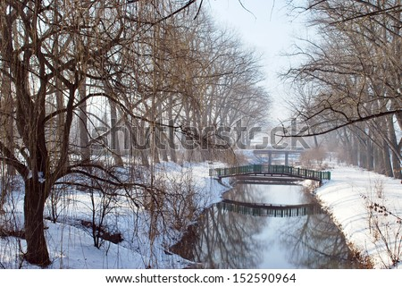 Park and river in snow - stock photo