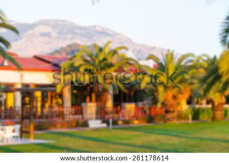 park area with buildings abstract blur background - stock photo