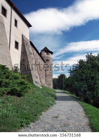 Park below fortification of Zvolen Castle located in Zvolen town, Slovakia. This castle is medieval fortified castle build in 14th century. These days complex of Zvolen Castle is opened for tourists. - stock photo