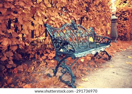 Park bench autumn urban landscape recreation - stock photo