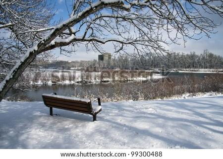 Park Bench by the Elbow River, Calgary, Alberta, Canada - stock photo