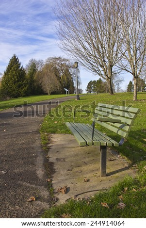 Park bench in a Public park Oregon. - stock photo