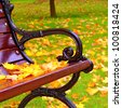 Park bench in autumn closeup - stock photo