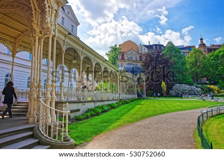Park Colonnade with wooden arbor, Karlovy Vary, Czech republic. People on the background