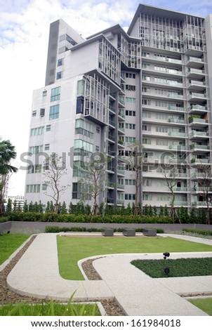 park courtyard and metro condominium - stock photo
