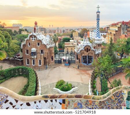 Park Guell in Barcelona. View to entrace houses with mosaics on foreground
