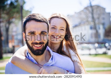 Park in summer. Young loving couple embracing - stock photo