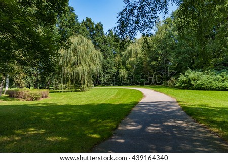 Park path road flowers trees green shadow - stock photo