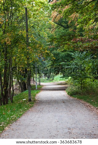 Park pathway in sunny day - stock photo