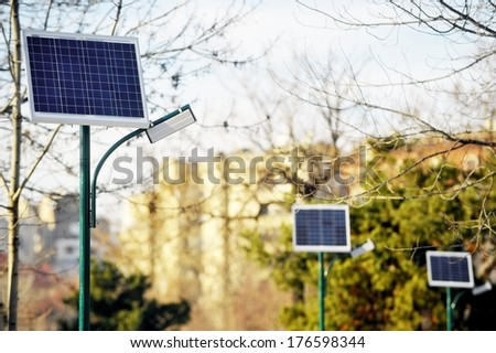 Park public lighting pole with photovoltaic panel  - stock photo