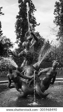 Park sculpture. Triton fountain in the round pool in Queen Mary's Garden in Regent's park, London, UK. Aged photo. Black and white. - stock photo