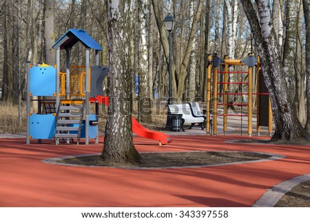 Park with a wooden child playground in early spring